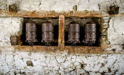 A mani wall with prayer wheels