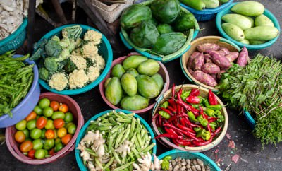Vegetables spread out for sell in the market.