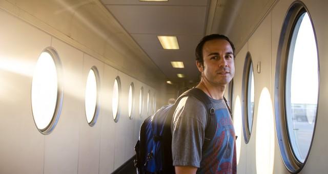 Adrian boarding a plane in Amsterdam